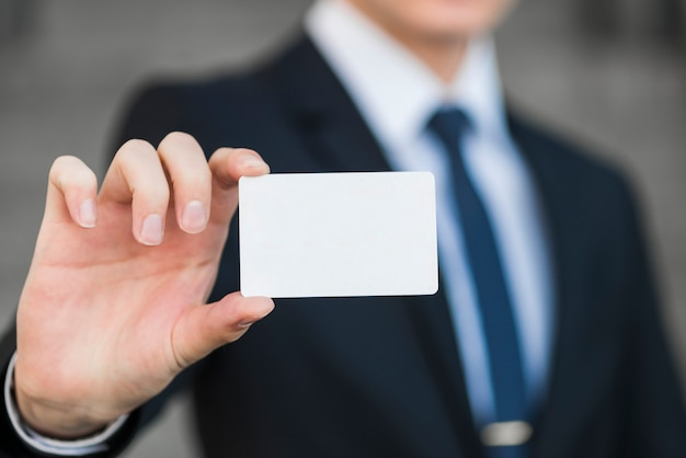 Businessman holding business card template Free Photo
