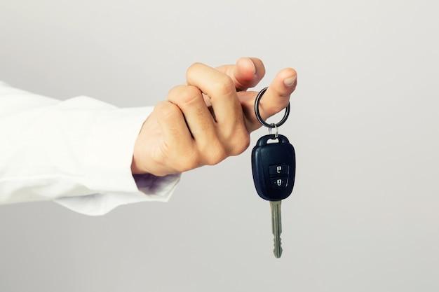 Businessman holding the  car key Premium Photo