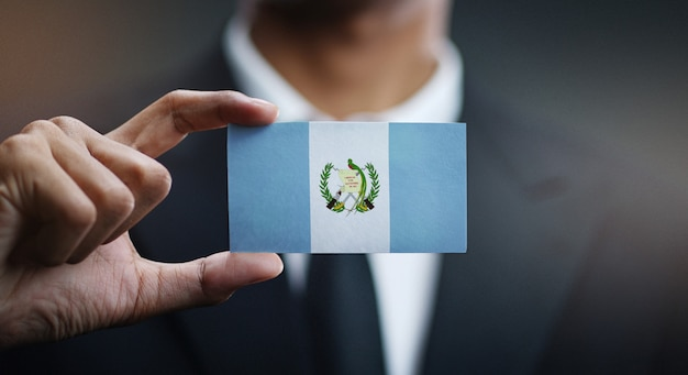 Businessman holding card of guatemala flag Premium Photo