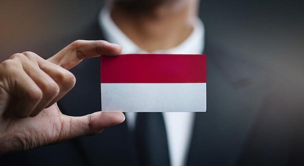 Businessman holding card of indonesia flag Premium Photo