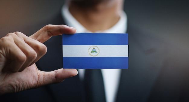 Businessman holding card nicaragua flag Premium Photo