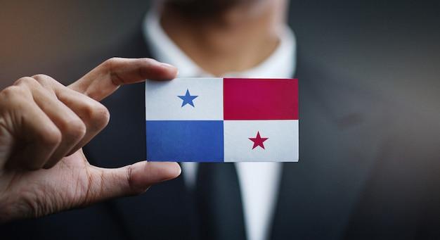Businessman holding card of panama flag Premium Photo