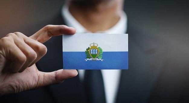 Businessman holding card of san marino flag Premium Photo