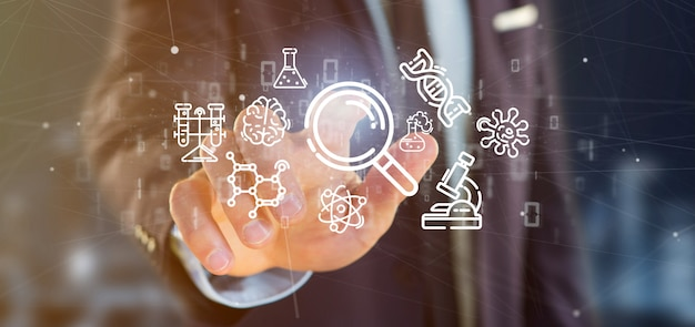 Businessman holding a cloud of science icon Premium Photo