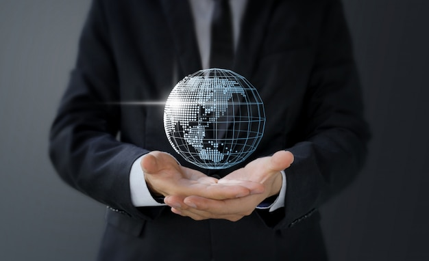 Businessman holding digital world map in hand Premium Photo