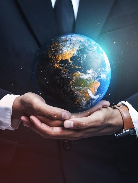 Businessman holding earth. Premium Photo