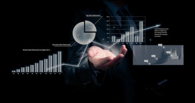 Businessman holding graph. business concept Premium Photo