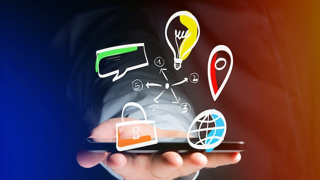 Businessman holding a hand drawn icon of business, multimedia and technology - start up concept Premium Photo