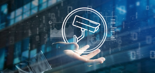 Businessman holding security camera system icon and statistics data -
