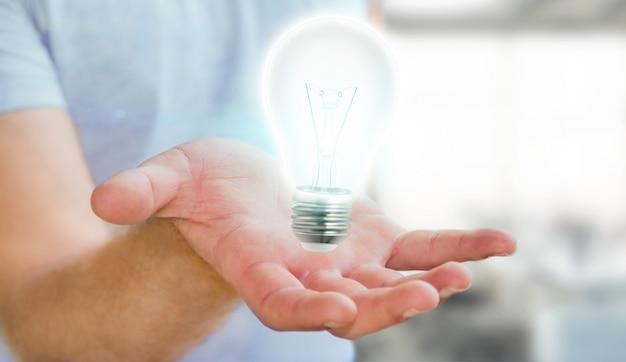 Businessman holding shiny lightbulb in his hand ã¢â€â˜3d renderingã¢â€â™ Premium Photo