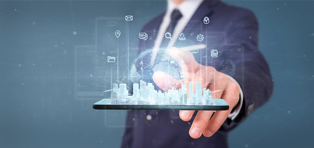 Businessman holding smart city user interface with icon, stats and data 3d rendering Premium Photo