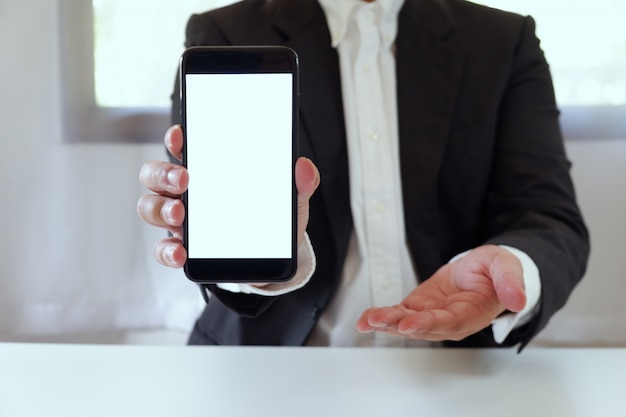 Businessman holding smartphone copy space Premium Photo
