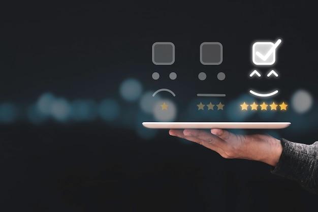 Businessman holding tabletand showing customer online evaluation result for five star.