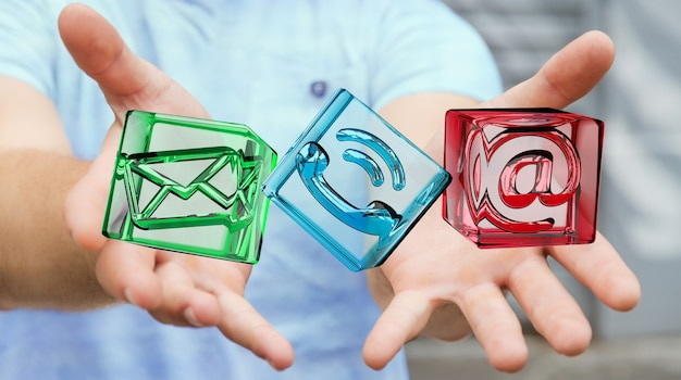 Businessman holding transparent cube contact icon in his hand 3d rendering Premium Photo