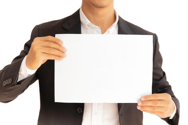 Businessman holding white clear paper board in hands isolated in clipping path. Premium Photo