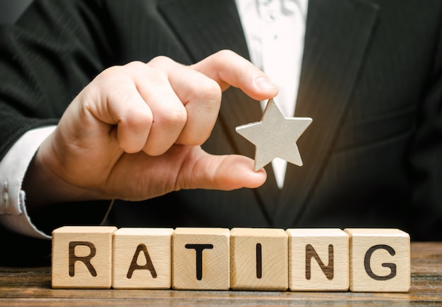 Businessman holds one star Premium Photo