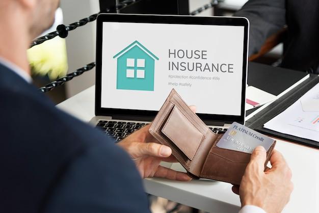 Businessman on house insurance Free Photo