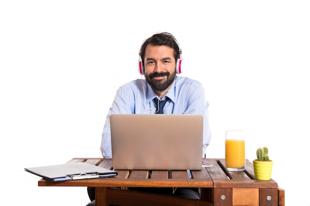 Businessman in his office listening music photo | free download.