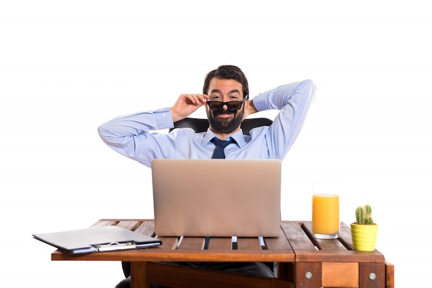 Businessman in his office with sunglasses Free Photo