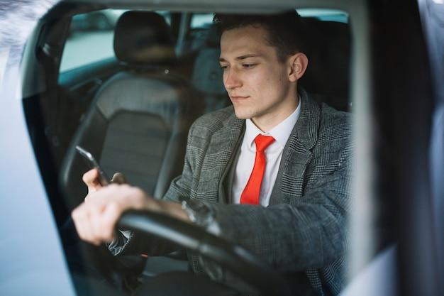 Businessman inside of a car Free Photo