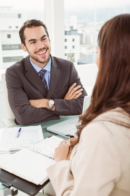 Businessman interviewing woman in office Premium Photo