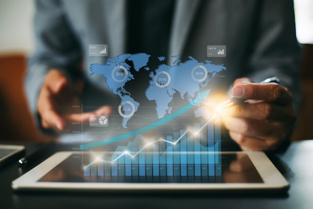 Businessman investment analyzing company financial report with digital graphs. Premium Photo