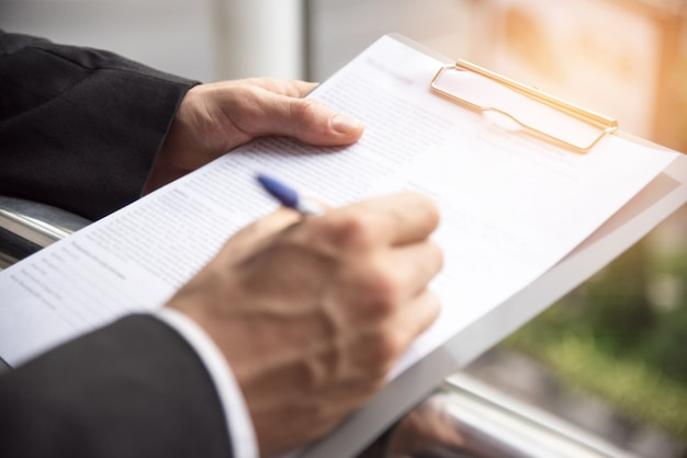 Businessman is signing at the sign paper Premium Photo
