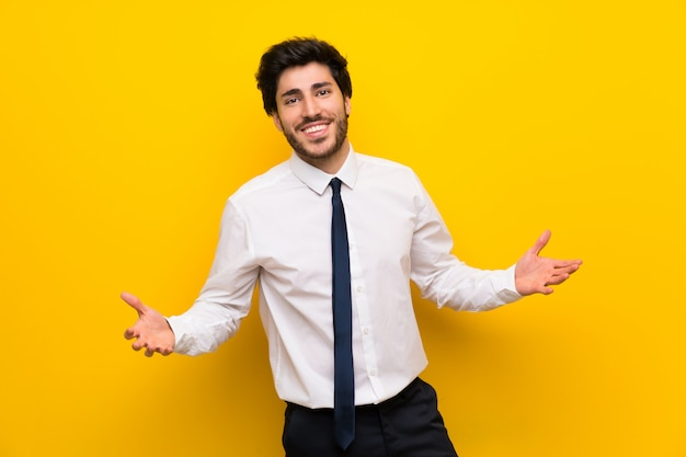 Businessman on isolated yellow  proud and self-satisfied Premium Photo