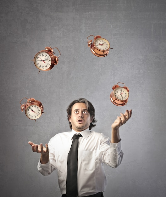 Businessman juggling with time Premium Photo