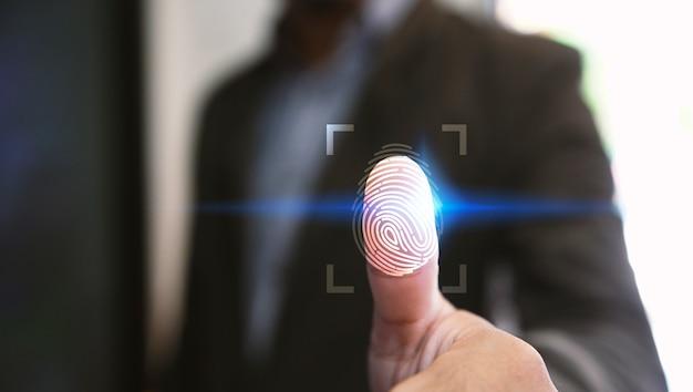 Businessman login with fingerprint scanning technology. Premium Photo