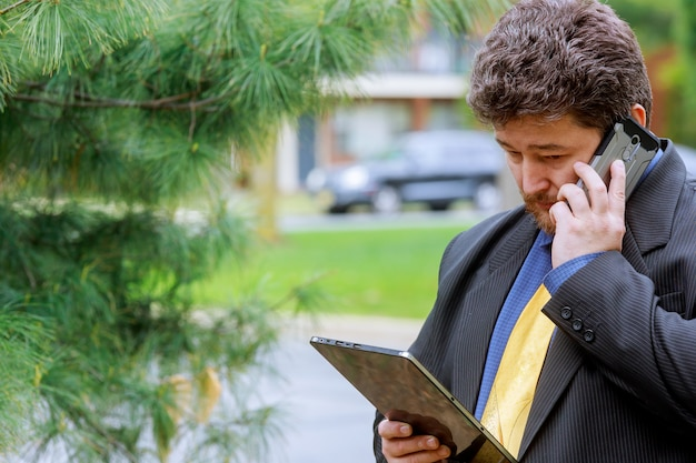 Businessman looking at phone in social network texting on the phone. Premium Photo