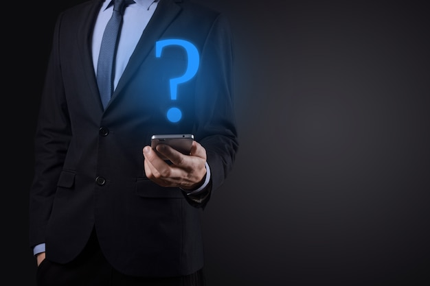 Businessman man hand hold interface question marks sign web Premium Photo