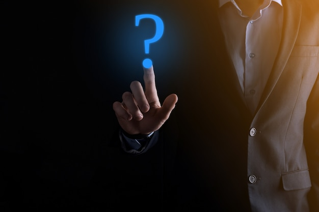 Businessman man hand hold smartphone phone interface question marks sign web. Premium Photo