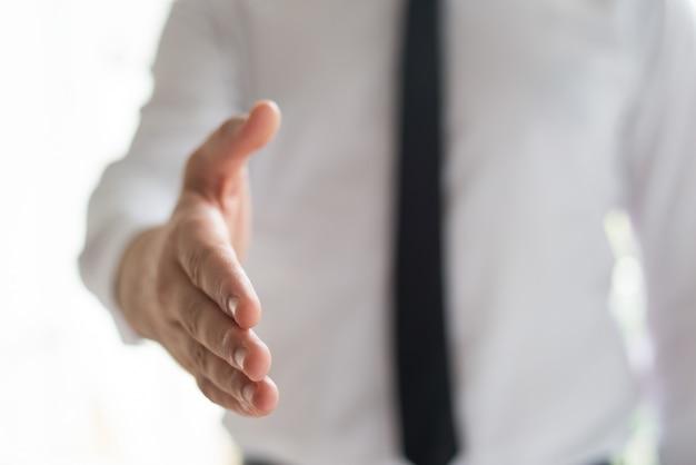 Businessman offering hand for handshake Free Photo
