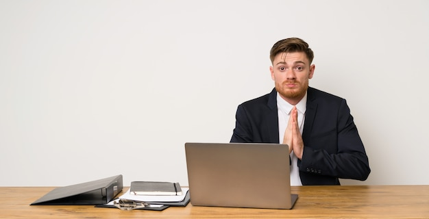 Businessman in a office keeps palm together. person asks for something Premium Photo