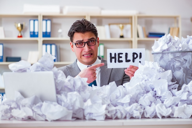 Businessman in paper recycling concept in office Premium Photo