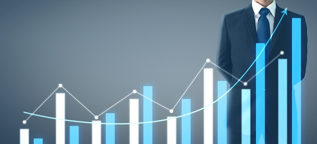 Businessman plan graph growth increase of chart positive indicators in his business Premium Photo