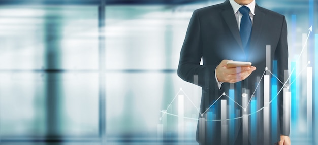 Businessman plan graph growth increase of chart positive indicators in his business. Premium Photo