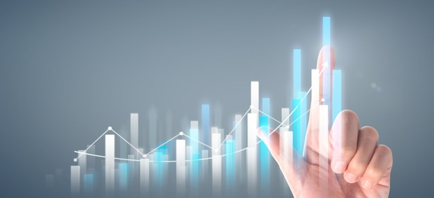 Businessman plan graph growth and increase of chart positive indicators Premium Photo