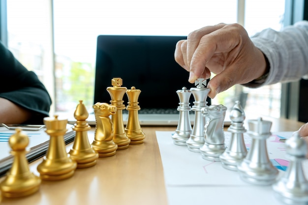 Businessman play chess on the marketing work place Premium Photo