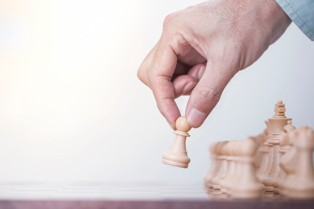 Businessman play with chess game in competition success play Premium Photo