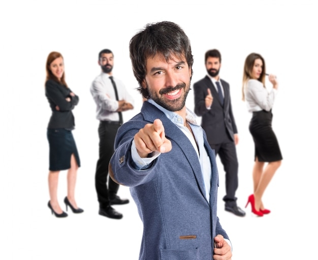 Businessman pointing to the front over white background Free Photo