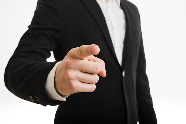 Businessman pointing towards you Free Photo