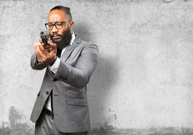 Businessman pointing with a pistol Free Photo