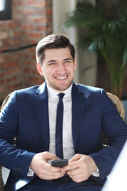 Businessman posing smiling Free Photo