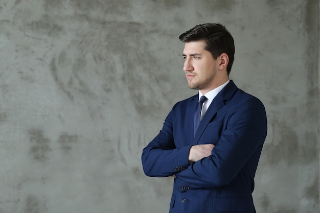 Businessman posing standing with his arms crossed Free Photo