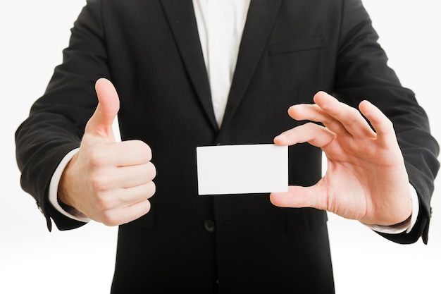 Businessman presenting business card and doing thumbs up gesture Free Photo