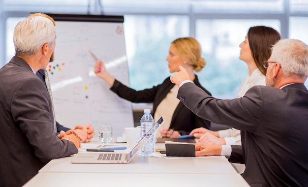 Businessman presenting new project to partners in office Free Photo