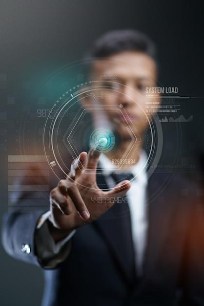 Businessman pressing circle hud hologram Premium Photo