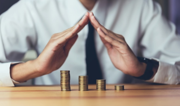 Businessman to prevent coins. growing concept. the financial goals success. Premium Photo